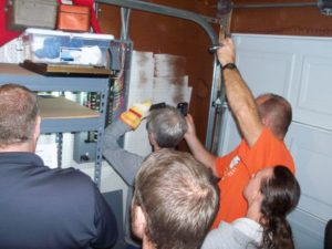 Students learning how to inspect and report on electrical panels
